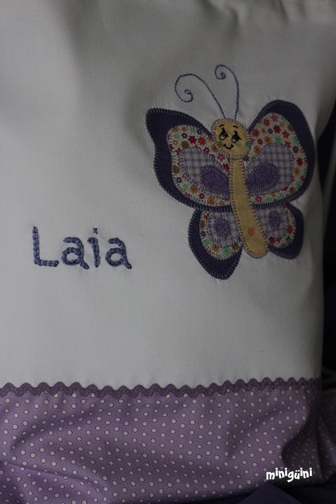 Detalle nombre y mariposa mochila